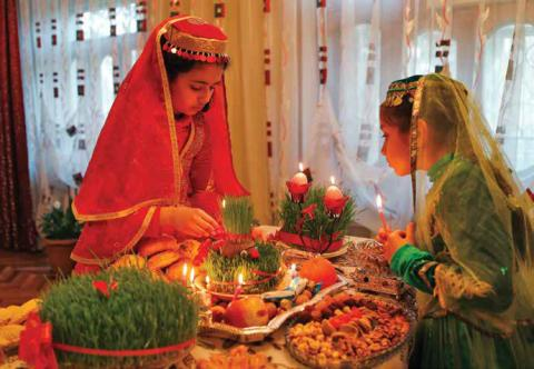 Girls decorate table for Novruz